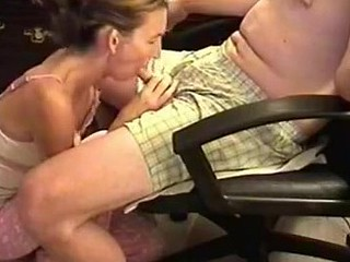She was a bit shy because the camera was shooting, but also horny. I sat in an armchair and she knelt in front to wrap her lips around my cock. Then, she performed one of the most excellent blowjobs ever.